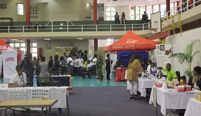 Dut students looking at the displays at the mental health and wellness fair.