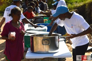 Pictured: Samukelo Dlamini serving meals to children.