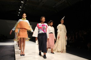 Zane Ngwenya with models showcasing her work